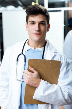 Portrait of handsome young man looking at camera in laboratory.
