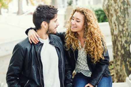 Portrait of beautiful young couple in the park. Stock Photo