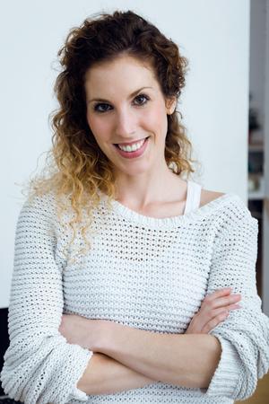 Portrait of beautiful young woman looking at camera at home. 版權商用圖片