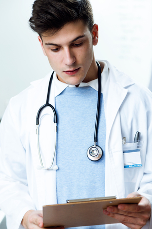 Portrait of handsome young man working in laboratory. Imagens