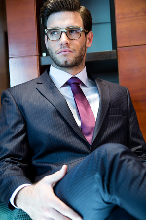Portrait of young businessman standing on office Stock Photo