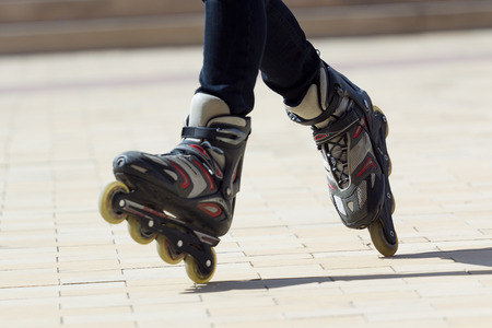 Close-up view of male legs in roller blades 版權商用圖片