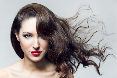 Photo of beautiful brunette woman with magnificent hair