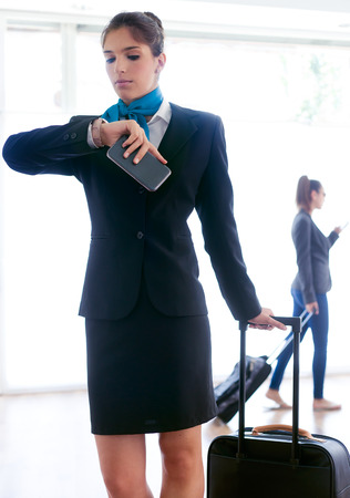 Portrait of beautiful hostess working in airport.