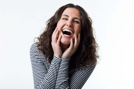 Portrait of beautiful young woman laughing. Isolated on white. Stock Photo
