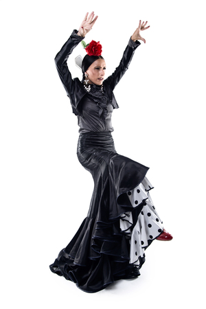 Portrait of pretty young flamenco dancer in beautiful dress.