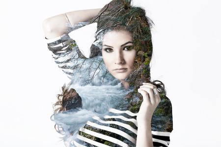 Double exposure portrait of beautiful Caucasian woman