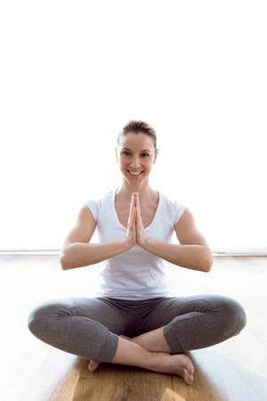 Portrait of beautiful young woman doing yoga exercises at home. Banco de Imagens - 111739683
