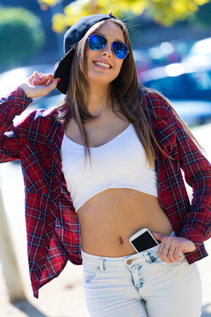 Outdoor fashion portrait of beautiful girl in the city. Stock Photo