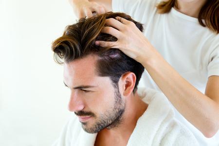 Portrait of masseur doing massage on man body in the spa salon.