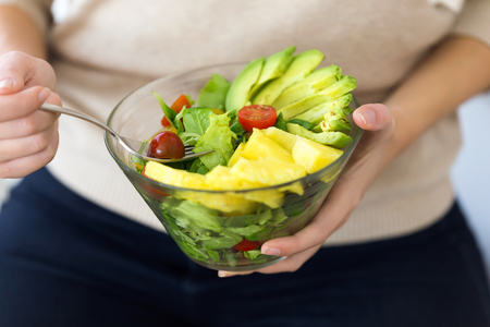 Close up of fruit salad with avocado and tomato. Stock Photo