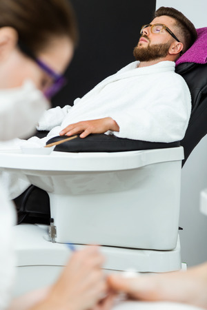 Portrait of young woman doing pedicure in salon. Beauty concept. 스톡 콘텐츠 - 111737229