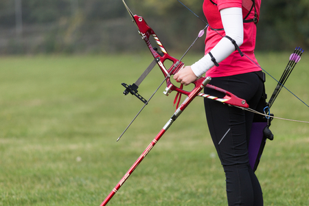 Portrait of female athlete practicing archery in stadium. Stock fotó