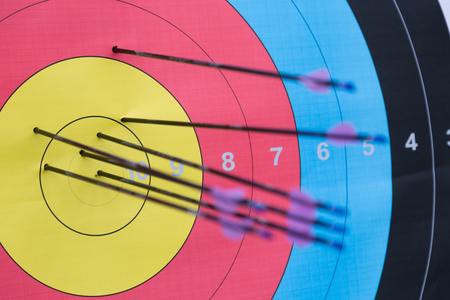 Close-up of archery target with arrows on it.