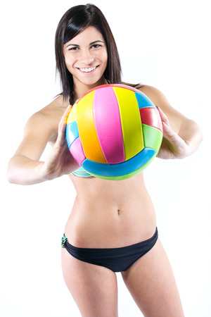 Beautiful young volleyball player woman in swimwear
