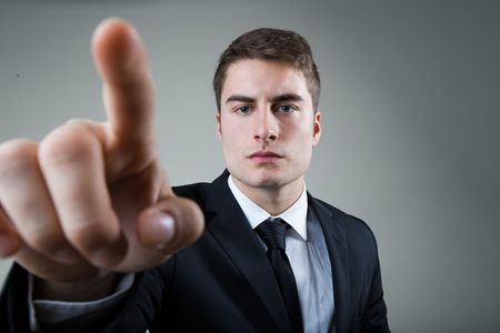 Portrait of business man with pointing to something or touching a screen. Archivio Fotografico - 111656273