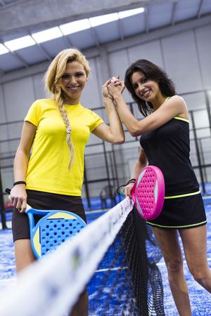 Portrait of handshake of paddle tennis players.