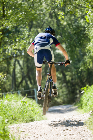 Portrait of handsome young man cycling in the mountain. Stockfoto - 111623886