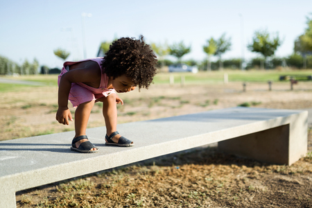 Portrait of a african american baby having fun in the park.