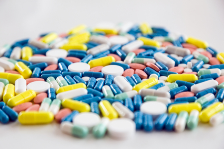 Portrait of assorted pharmaceutical medicine pills and capsules on the table.
