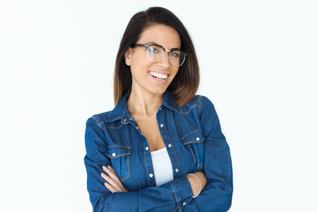 Portrait of pretty young woman with eyeglasses and perfect smile looking at camera. Isolated on white.
