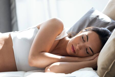 Shot of pretty young woman sleeping in the bed at home. Peace and calm concept. Stock fotó