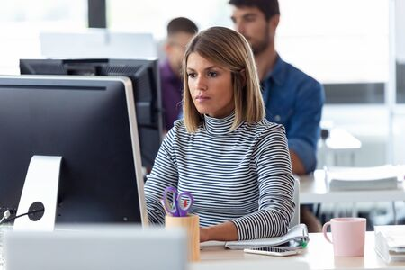 Shot of software developer working with computer in the modern startup office.