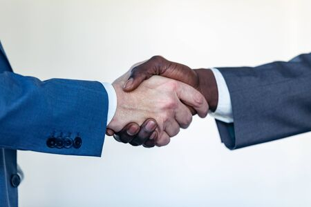 Close-up view of business partner handshaking process. Successful deal concept after great meeting.