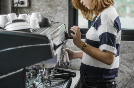 20   24: Blurred Background : Girl barista in thailand vintage in cafeshop