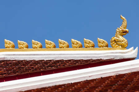 ornately: detail of ornately decorated temple roof in bangkok, thailand
