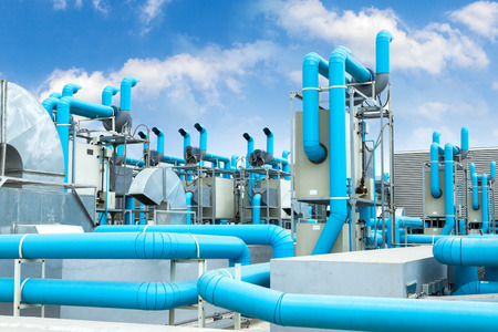 mechanical ventilation: Industrial air conditioner on the roof with blue sky