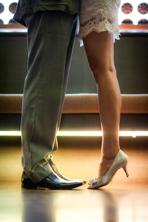 Romantic Legs and shoes of a man and woman photo