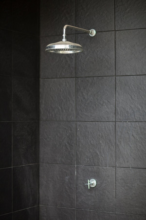 tap room: head shower at swimming pool Stock Photo