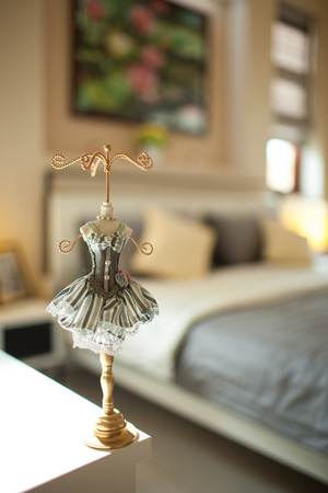 Antique jewelry holder, with dress in the bedroom photo