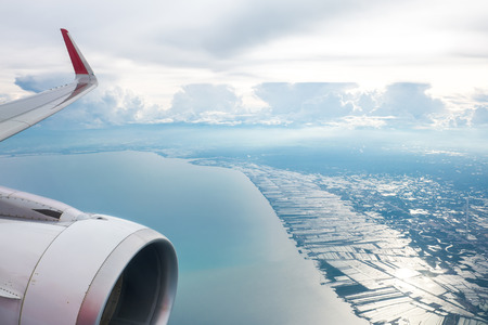 Classic image through aircraft window onto jet engine Stock Photo