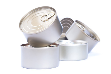 Pile of Aluminum cans food,  isolated white background. photo