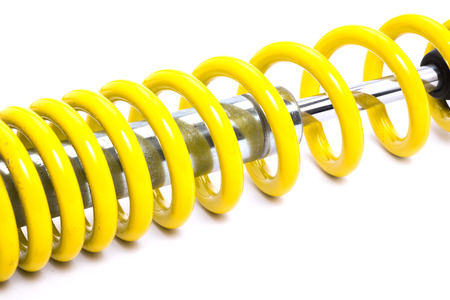 decelerator: Clolse up Yellow Shock absorber. isolated on white background