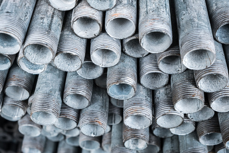 joist: Close up group of stack of iron pipes in an iron shop