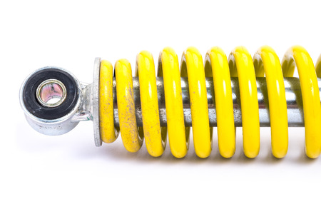 Clolse up Yellow Shock absorber. isolated on white background