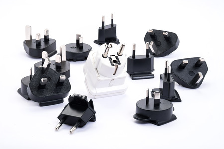 group of black and white universal adapter isolated on white background photo