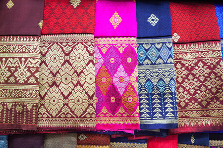 stack of traditional colourful sarong in the shop. for a background