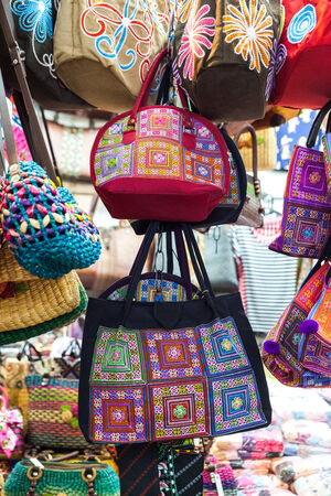 handcrafted: Group of different traditional hand-made bag thai designs. Stock Photo