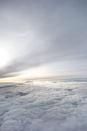 clouds. view from the window of an airplane flying in the clouds Фото со стока
