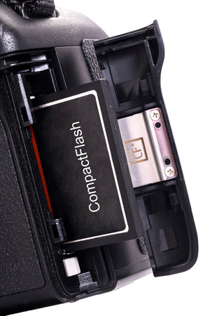 Close Up Professional DSLR camera with inserted memory card. isolated on white background Фото со стока