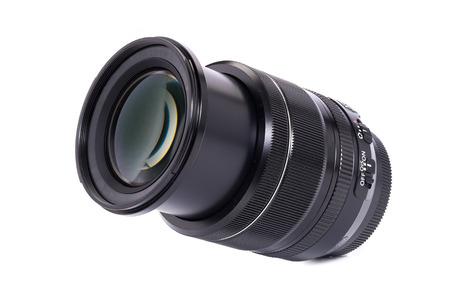 Black camera lens for DSLR isolated on white background