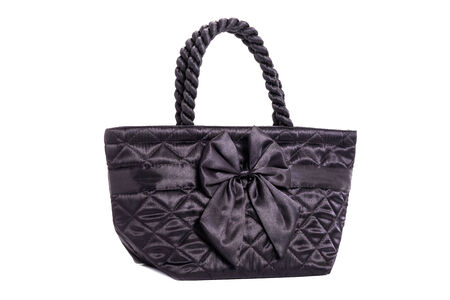 Black Handbag made of Thai silk decorated with ribbon isolated at white background Фото со стока