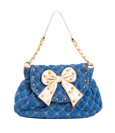 Blue jeans women bag decorated with gold ribbon isolated at white background