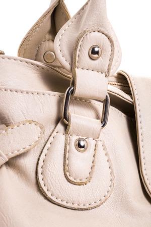 Close-up photo of a handbag leather female handbag on white background