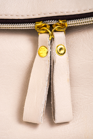 Brown leather with zipper for background