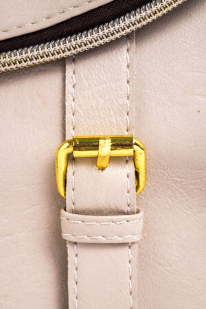 Brown leather background with a gold belt